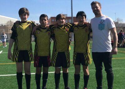 Los cuatro sub-14 de la Escuela Robher Asesores León RC con la selección de Castilla y León
